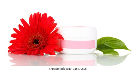 Jar of cream with flower isolated on white