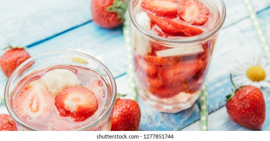 Jar of delicious strawberry and banana homemade smoothie on wooden background