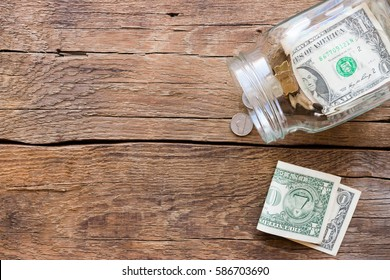 jar for donations with scattered money