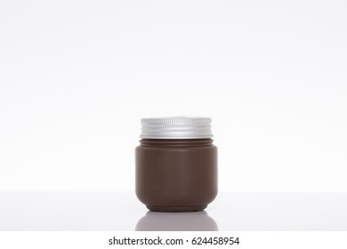 Jar of face cream isolated on white background with reflection