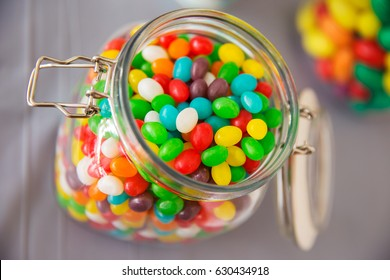 A jar filled to the brim with multicolored jelly beans