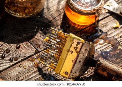 jar of fresh honey in a glass jar, beekeeping tools outside. frame with bees wax structure full of fresh bee honey in honeycombs. Beekeeping concept. Top view. Copy space.