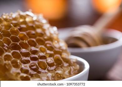 Jar full of fresh honey and honeycombs