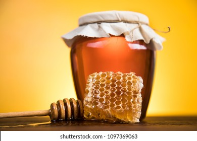 Jar full of fresh honey and honeycombs