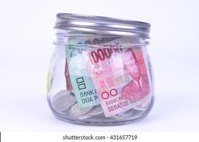 A jar full of Indonesian Rupiah notes
