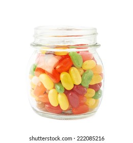 Jar full of jelly bean candy sweets, composition isolated over the white background