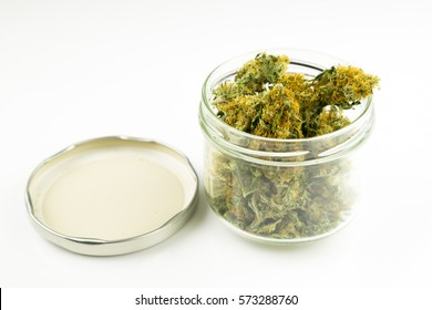 A jar full of medicinal marijuana studio shot on white background - Alternative medicine