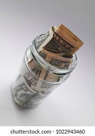 Jar full of money/dollars isolated on white background