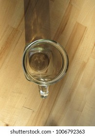 Jar with handle on wooden table