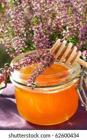 a jar of heather honey in autumn garden
