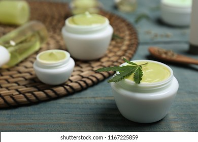 Jar of hemp lotion on wooden table