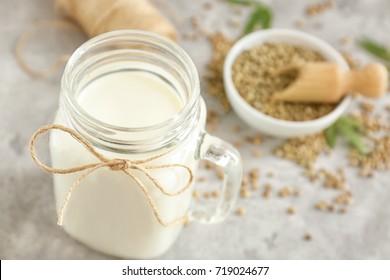 Jar with hemp milk on kitchen table