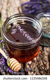 Jar of Herbal Honey with Lavender Flowers. Selective focus.
