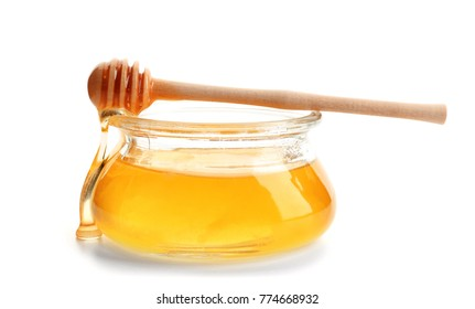 Jar of honey with dipper, isolated on white