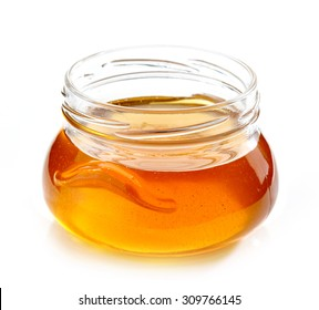 jar of honey isolated on white background