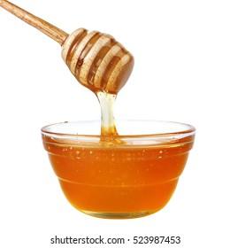 Jar of honey isolated on a white background