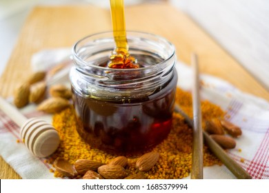 jar of honey on the table homeliness pollen nuts