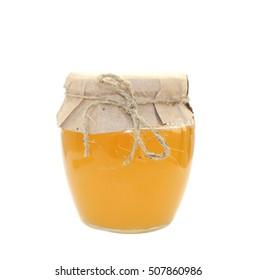 A jar of honey on white background