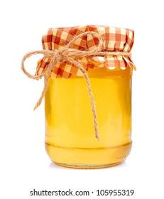 Jar of honey on white closeup