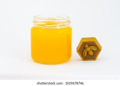 Jar of honey and wax