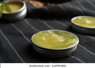 Jar lid with hemp lotion on striped fabric