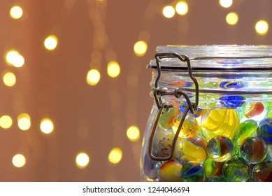 Jar of Marbles and Christmas festive lights