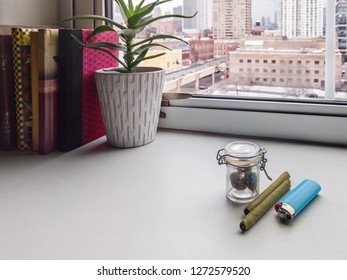 A jar of marijuana weed with cigars and lighter on a counter near a window. Tetrahydrocannabinol THC, marijuana effects.