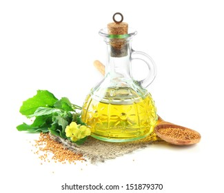 Jar of mustard oil and seeds with mustard flower, isolated on white