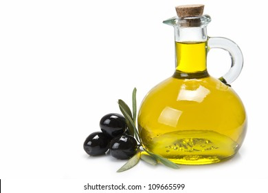 A jar with olive oil and some black olives isolated over a white background.