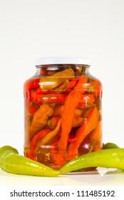 Jar of paprika with fresh vegetables