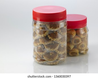 jar of pineapple tart in plastic container on white background