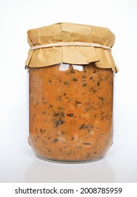 jar of ribollita, meaning reboiled, Tuscan soup made with bread and vegetables including leftover bread, cannellini beans, carrot, cabbage, beans, silverbeet, kale, and onion