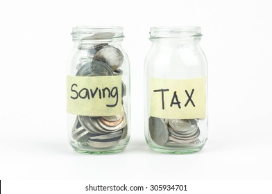 Jar for savings and taxes full of coins.
