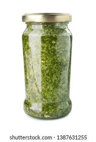 Jar of tasty pesto sauce isolated on white