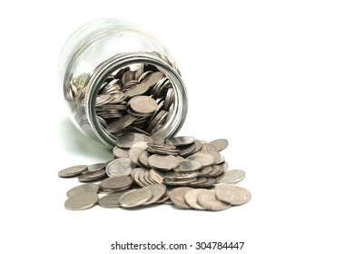 Jar of thai coins spilled on a white background