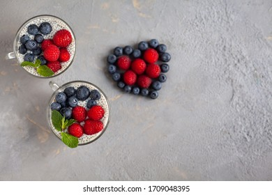 Jar with vanilla chia pudding topped with freezed berries