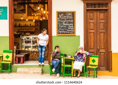 Jardin, Colombia. April 2018. A view of a colorful cafe in the main square in the picturesque town of Jardin in Colombia.