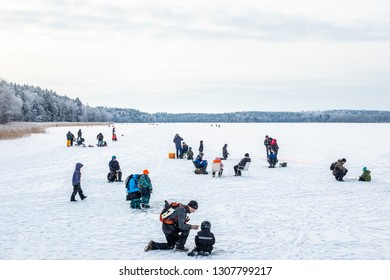 JARFALLA, SWEDEN - JANUARY 27, 2019: Winter landscape view of many people on a frozen lake ice fishing in Jarfalla Sweden January 27, 2019.