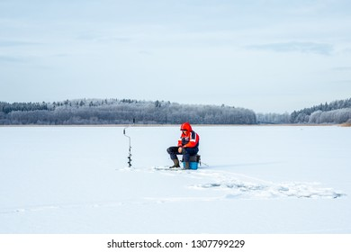 JARFALLA, SWEDEN - JANUARY 27, 2019: Winter landscape view of one elderly male on a frozen lake ice fishing in Jarfalla Sweden January 27, 2019.