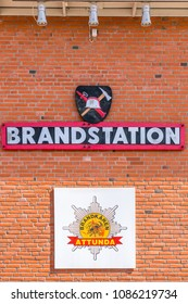 JARFALLA, SWEDEN - MAY 6, 2018: Front view of a exterior brick wall on a fire station with signs and text in Jarfalla May 6, 2018.