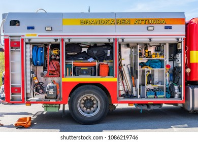 JARFALLA, SWEDEN - MAY 6, 2018: Outdoor side view of a rescue firetruck vehicle with open hatches displaying different equipment in Jarfalla May 6, 2018.