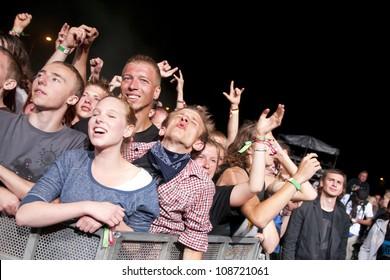 JAROCIN, POLAND - JUNE 22: A crowd of unidentified fans enjoy music at the Jarocin Festival in Poland on June 22, 2012 in Jarocin, Poland