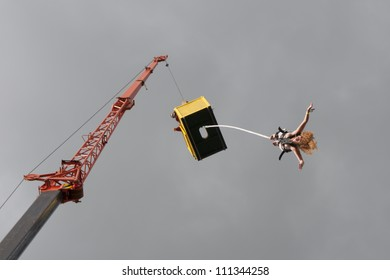 JAROCIN, POLAND - JUNE 22: An unidentified naked fan of rock and punk music jumps on bungee at Jarocin Festival in Poland on June 21, 2012 in Jarocin in Poland