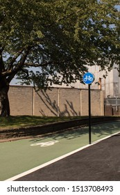 Jarrow / Great Britain - August 25, 2019 : Cycle lane ramp with railing and blue round cycle bike sign