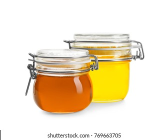 Jars with aromatic honey on white background