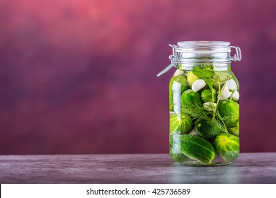 Jars with assortment of pickled vegetables.
