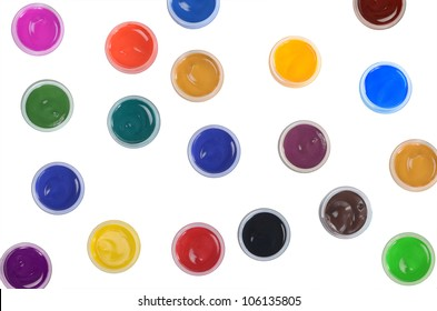 Jars with colour paints on white background