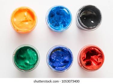 Jars with gouache paint