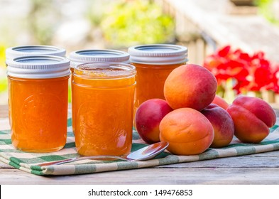 Jars of homemade apricot jam or preserves