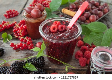 Jars with homemade jams made from fresh berries